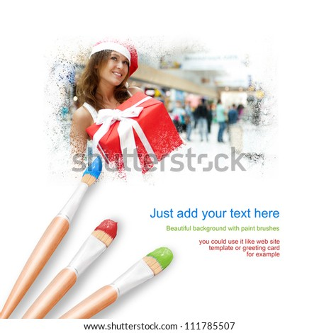 White background with three paintbrushes painting portrait of beautiful young woman wearing Santa Claus hat and gift box
