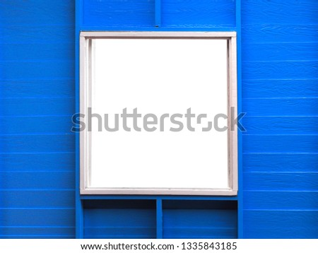 white background with window photo frame. this blue wall is made from artificial wood.