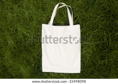 white bag on the green grass