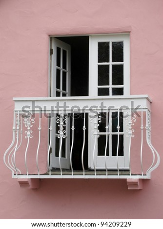 White Balcony on a pink house