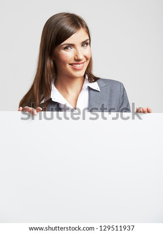 White banner . Business woman hold white blank paper. Young smiling woman show blank board. Close up female model portrait isolated on white background.