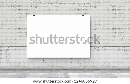 White banner on a white brick wall