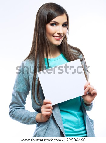 White banner .Teenager girl hold white blank paper. Young smiling woman show blank board. Close up female model portrait isolated on white background.