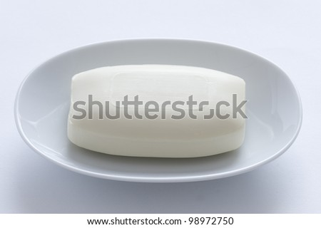 white bar of soap in a dish