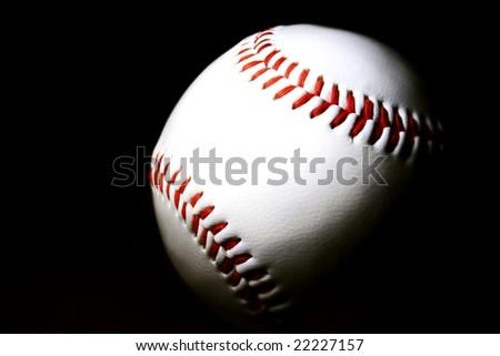 white baseball against dark background