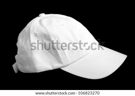 White baseball cap isolated on black background
