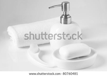 White bath accessories on light background. - stock photo