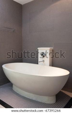 white bath in brown bathroom