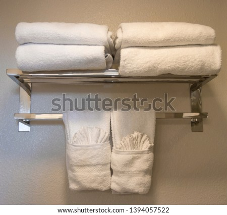 White bathroom towels hanging on the rack. #1394057522