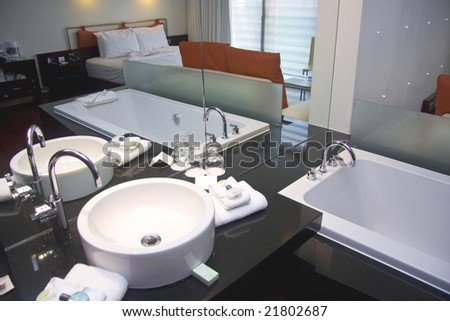 White bathtub and sink in spa hotel room