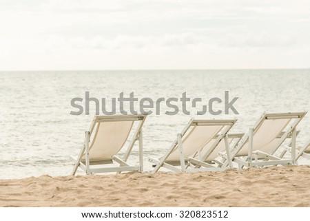 White beach beds on sand beach,vintage filter