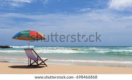 White beach chairs and umbrellas on Katanoi  Beach, Phuket, Thailand #698466868