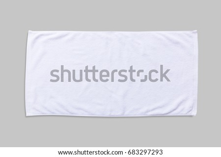 White beach towel mock up isolated with clipping path on grey background, flat lay top view Foto stock ©