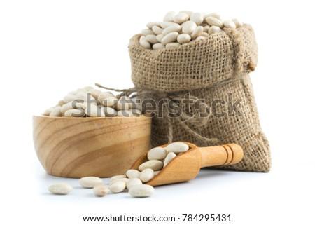 white beans on a sack vegetarian food  on white #784295431