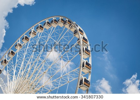 White Beautiful large Ferris wheel with blue sky background