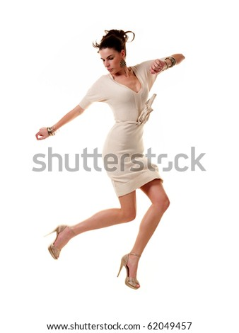 White beauty young woman in white dress in various jump positions. Photo on white background.