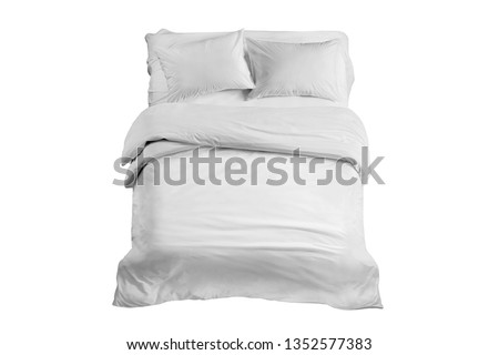 White bed isolated, white bed linen isolated. Bed with bedding, duvet and two pillows isolated