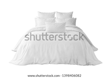 White bed linen on a white bed isolated. Bedroom with bed and linen against white background. Bed with pillows and duvet isolated. Front view.