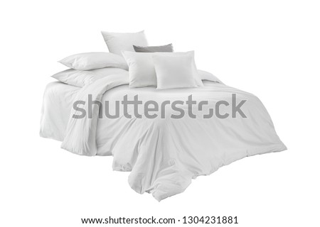 White bed linen on a white bed isolated. Bedroom with bed and linen. Bed with pillows and duvet isolated.