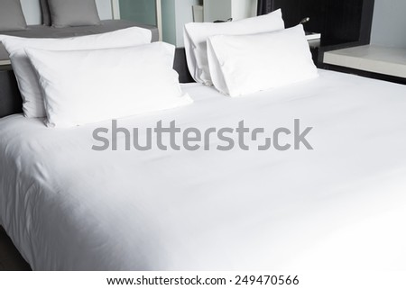 White bed sheets and pillows #249470566
