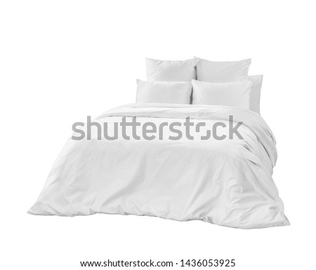 White bed side front view. White bedding isolated. White bed linen on a white bed.