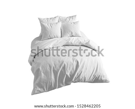 White bedding items isolated. Bed linen on a white bed isolated. Bedroom with bed and linen. Bed with four pillows and duvet isolated. Side view.