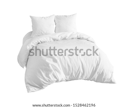 White bedding items on the bed isolated. Bed linen on a white bed isolated. Bed with two pillows and duvet isolated. Side view.