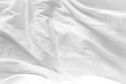 White Bedding Sheet Texture Close-up. Cotton Sheet Creased Drapery Fold Structure On Bed. Unmade Textile Background Wrinkle Blanket.