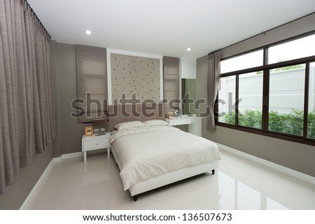 White bedroom with big window