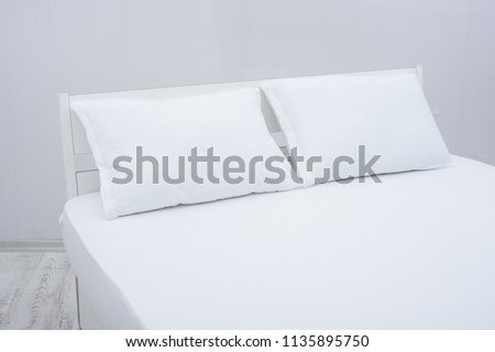 white bedsheet and pillow