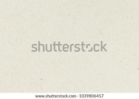 White beige paper background texture light rough textured spotted blank copy space background in beige yellow,brown