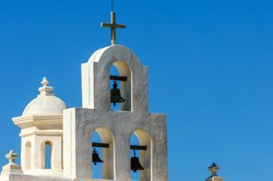 White bell tower of Mission San Xavier del Bac (famous White Dove of the Desert) in Tohono O'odham Indian Reservation, Arizona, USA