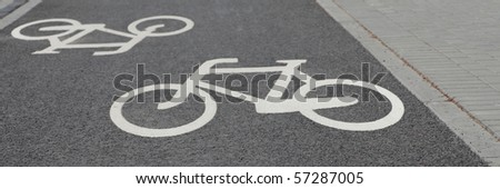 white bicycle road sign black