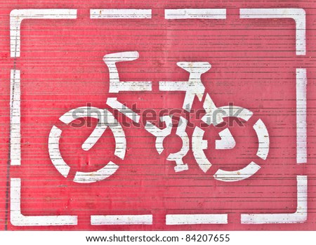 White bicycle sign in frame on red background