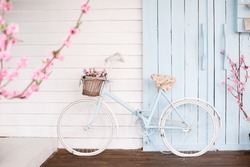 White Bicycle With Beautiful Flower Basket on vintage background in spring season