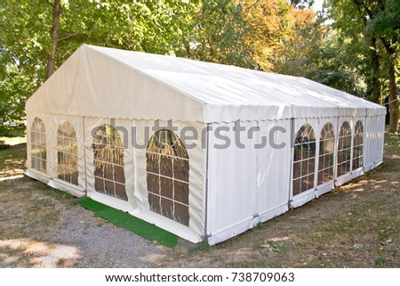 White big tent in forest #738709063