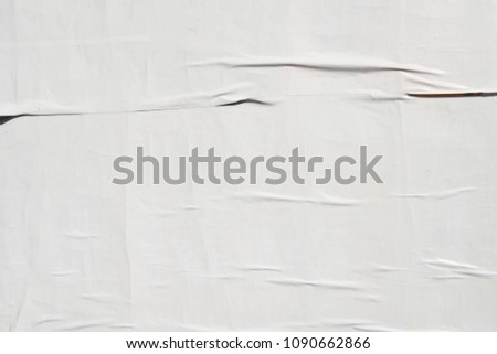 white billboard poster glued to wall