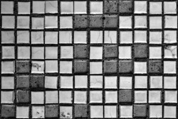 White black grey wall with cracked square and rectangular tiles, texture background