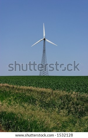 White blades of a wind powered electricity generating  wind turbine - an alternative renewable energy source