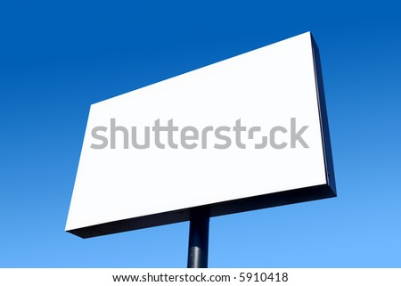 White blank billboard and a blue sky.