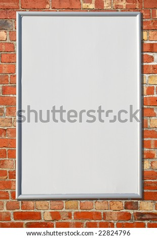 White blank billboard sign on a red brick wall.