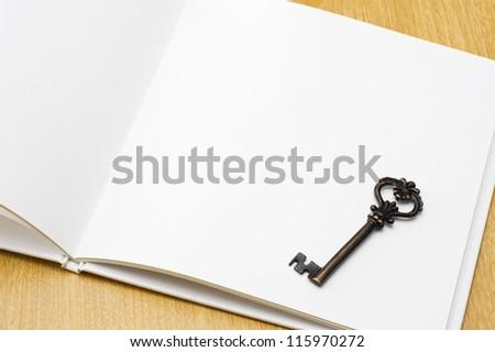 White blank book with retro key.