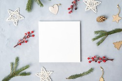 White blank canvas board and Christmas decoration on grey canvas backdrop. Top view. Mockup poster, Christmas concept.