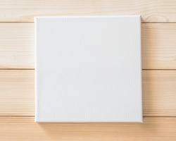 White blank canvas frame mockup square size on white wood wall for arts painting and photo hanging interior decoration
