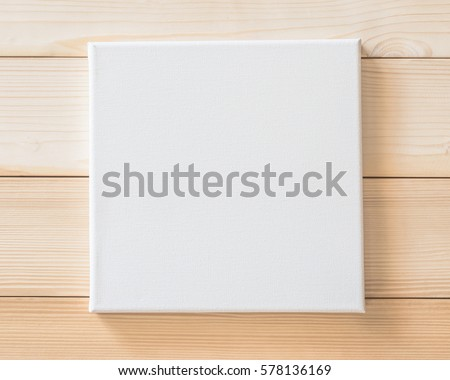 White blank canvas frame mockup square size on white wood wall for arts painting and photo hanging interior decoration #578136169