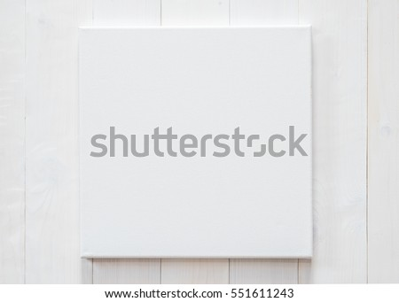 White blank canvas mockup square size on white wood wall for arts painting and photo hanging interior decoration #551611243