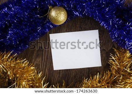 White blank card with decoration balls and tinsel. Place for text