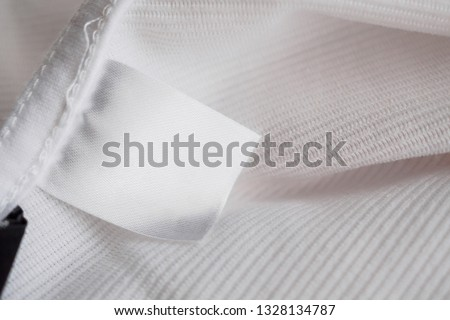 2d68aab00ddfdf Blank white fabric label on fabric background Images and Stock ...