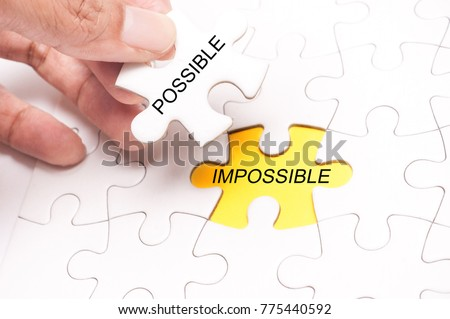 White Blank jigsaw puzzle with missing pieces written with text Possible and Impossible. #775440592