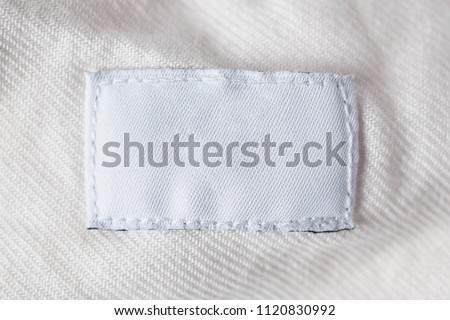 White blank laundry care clothes label on cotton shirt #1120830992
